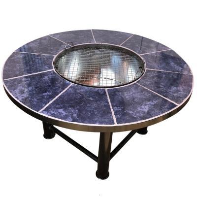 Brasero mesa con parrilla redondo