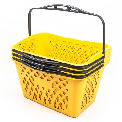 Canasto con manilla amarillo