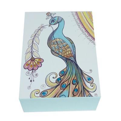 Caja decorativa pavo real celeste 20x15x8 cm