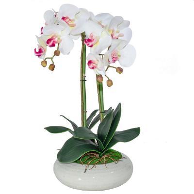 Planta artificial flor con macetero blanco