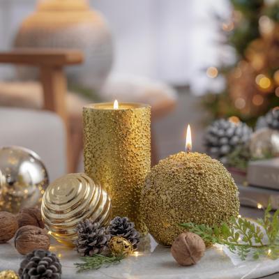 Vela texturada esfera dorada