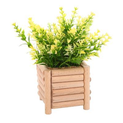 Planta artificial maceta madera 20 cm amarillo