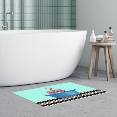 Alfombra vinílica baño 50x70 cm chanchos