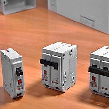 Interruptores automáticos, tableros y medidores